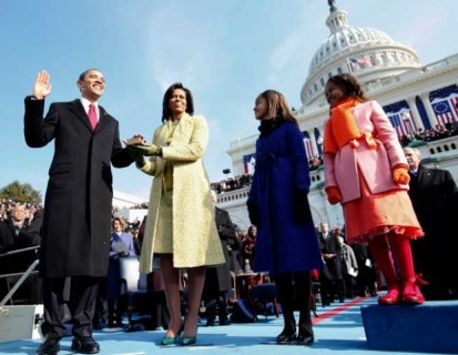 President Obama, with his family, getting inaugurated. First Black POTUS? Waitaminute, flag on the play!!
