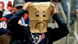 HOUSTON, TX - NOVEMBER 24:  A Houston Texans fan screams in the stands late in the fourth quarter during the game against the Jacksonville Jaguars at Reliant Stadium on November 24, 2013 in Houston, Texas.  (Photo by Scott Halleran/Getty Images)
